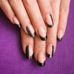 French manicure with black tips.