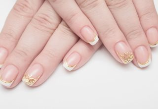 French manicure with a touch of gold.