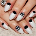 Almond shaped nails with classic design.