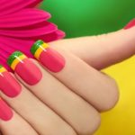 Colorful nails in pink, green and yellow.