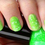 Vivid green with white flecks.