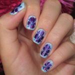 Light blue and indigo nail art.