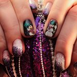 Purple glitter ombre effect with snowmen.