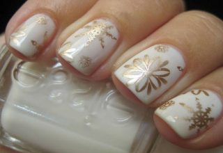 Gold snowflakes on white.
