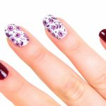 Small purple flowers on white base coat..