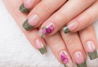 Purple flower with glittery French tips.