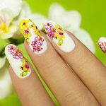 Pink and yellow flower nail art for summer.
