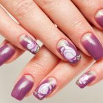 Deep purple nails with flowers.