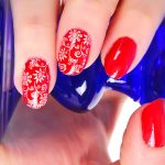 Red nail polish with a floral print.