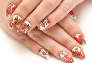 Nail art featuring poppies.
