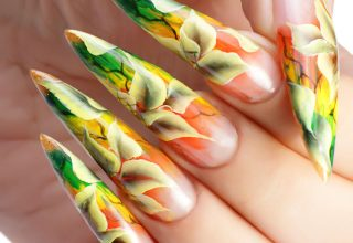 Sharp points on autumnal nails.