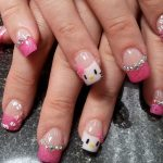 Pink nails with Hello Kitty motif.