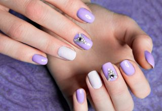 Pastel nail art with shades of lilac.