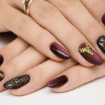 Mauve shaded finger nails.