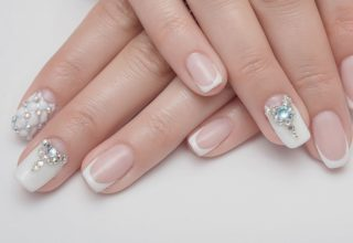 Sparkly nail art shaped like the Eiffel tower.