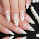 Sparkly tips on sharp glitter nails.