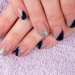 Chevron shape with overlaps of silver and navy.