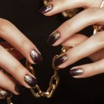 Ombre prom nails with gold and purple.