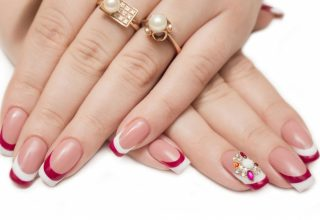Tips of red and white with a cluster of jewels in a floral shape.
