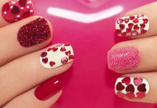 Heart shaped gems glued onto short nails.