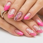 A row of diamond with pink nail tips.